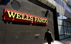 Wells Fargo will sell its asset management business to two private equity firms for $2.1 billion.