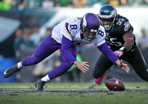 Vikings quarterback Sam Bradford scrambles to regain control of the ball after being hit hard by Eagles Brandon Graham in the 4th quarter.