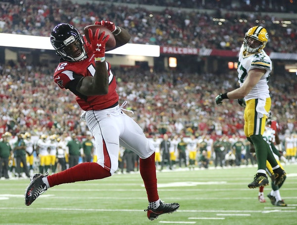 Atlanta Falcons wide receiver Mohamed Sanu catches a touchdown pass from Matt Ryan past Green Bay Packers defender Jake Ryan for a 33-32 victory on Su