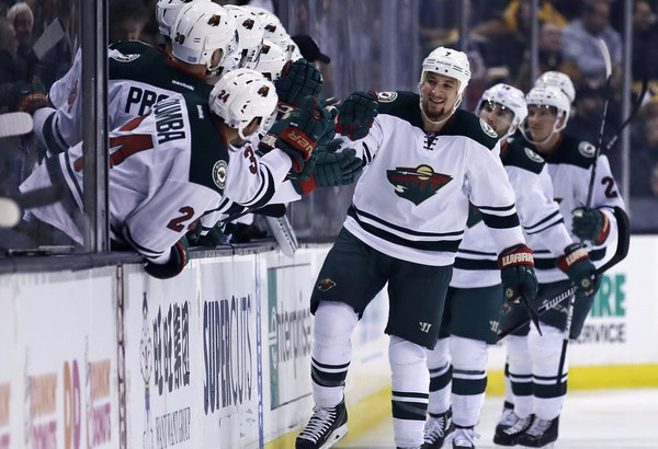Minnesota Wild right wing Chris Stewart, center, is congratulated by teammates after his goal against Boston Bruins goalie Malcolm Subban during the s