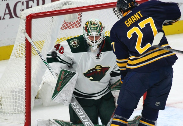 Buffalo Sabres' Derek Grant (27) is stopped by Minnesota Wild goalie Devan Dubnyk (40) during the second period of an NHL hockey game, Thursday, Oct.