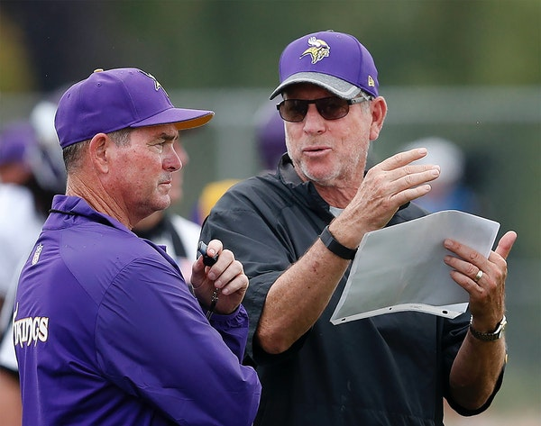 Head coach Mike Zimmer and Norv Turner in August.