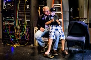 Gus Walz, 9, played a video game and sat with his dad, Democratic Rep. Tim Walz, before a big political event in June. Walz was running strong in the