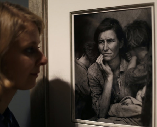 """American photographer Dorothea Lange's """"Migrant Mother"""" is among examples of Elton John's collection shown at the Tate Modern gallery in Londo"""