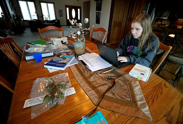 Claire Westra worked on college courses at home in Fulda, Minn. The high school doesn't allow students in the building while they're doing college