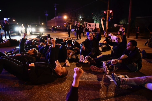 Protesters in St. Paul held a die-in at Marshall and Hamline avenues during a march Wednesday night for Philando Castile.