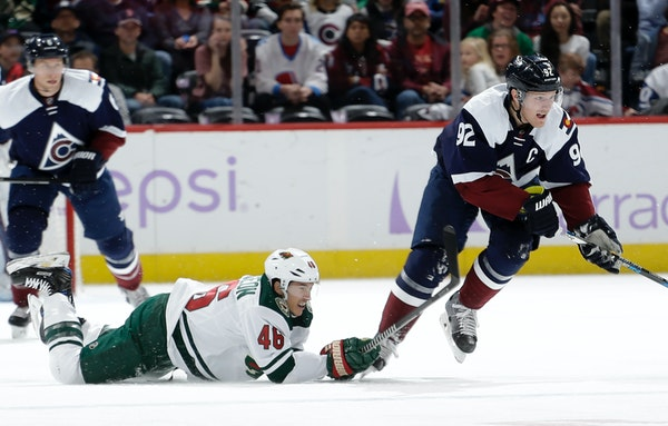 Minnesota Wild defenseman Jared Spurgeon (46) falls to the ice while chasing Colorado Avalanche left wing Gabriel Landeskog (92) during the first peri