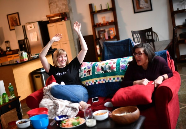 """Katie Sisneros, left, celebrated as it was announced that a future episode of """"The Great British Bake Off"""" would include savory pastries. To her r"""