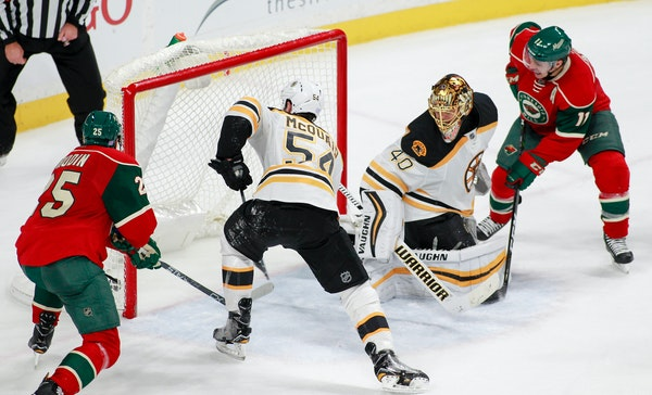 Minnesota Wild defenseman Jonas Brodin, of Sweden (25) and the Wilds' Zach Parise watch as teammate Mikael Granlund's, not pictured, scores against Bo