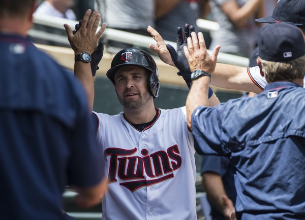 Minnesota Twins second baseman Brian Dozier (2) celebrated with teammates in the dugout after hitting a solo home run to bring the score 5-3 in the fi