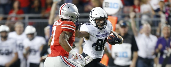 Northwestern receiver Austin Carr, right, races upfield against Ohio State cornerback Damon Arnette during the second half of an NCAA college football