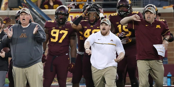 The Gophers bench, including coach Tracy Claeys, left, reacted to Antoine Winfield Jr.'s fumble recovery Saturday. The victory over Purdue left the