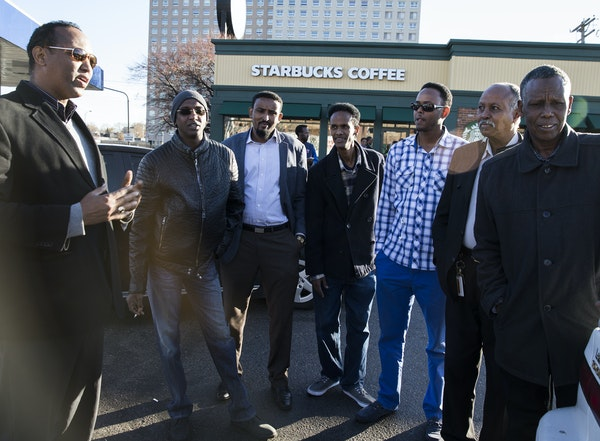 A group of Somali men discussed politics outside the Starbucks in the Cedar-Riverside neighborhood of Minneapolis on Wednesday.