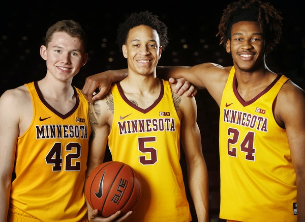 Freshmen Michael Hurt (42), Amir Coffey (5) and Eric Curry already have given Gophers fans a glimpse of what they'll bring to the court this season.