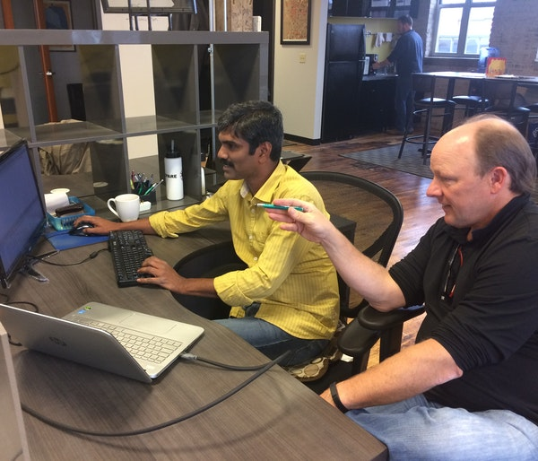 Sudheer Prem, left, and Adam Elliott have helped ID Insight save one bank $20 million in fraud losses in recent years.