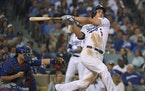 FILE - In this Oct. 18, 2016, file photo, Los Angeles Dodgers' Corey Seager hits an RBI single during the third inning of Game 3 of the National Leagu