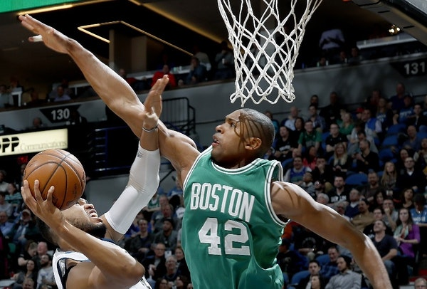 The Wolves' Karl-Anthony Towns found his way blocked by the Celtics' Al Horford in the fourth quarter. ] CARLOS GONZALEZ cgonzalez@startribune.com - N