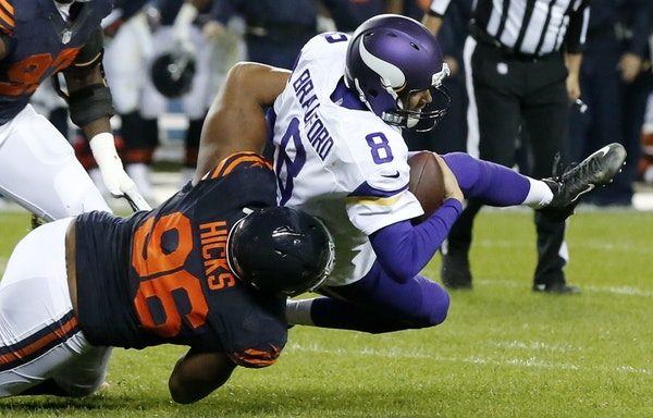 Bears defensive end Akiem Hicks dragged down Vikings quarterback Sam Bradford on third-and-goal Monday night, forcing the Vikings into attempting a fi