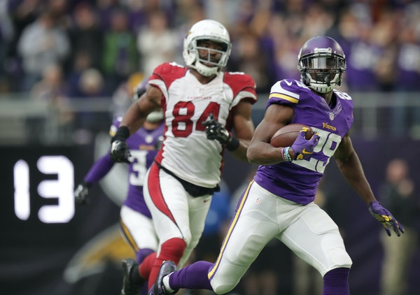 Vikings Xavier Rhodes runs past Cardinals Jermaine Gresham after intercepting a Carson Palmers pass and running it back 100 yards for the TD in the 2n