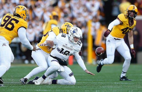 Minnesota linebacker Blake Cashman sacked Northwestern's quarterback Clayton Thorson (18), forcing a fumble in the first quarter