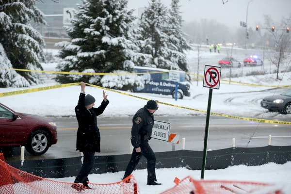 Authorities investigate the scene where an officer-involved shooting occurred early Wednesday at Bren Road and Highway 169 in Edina.