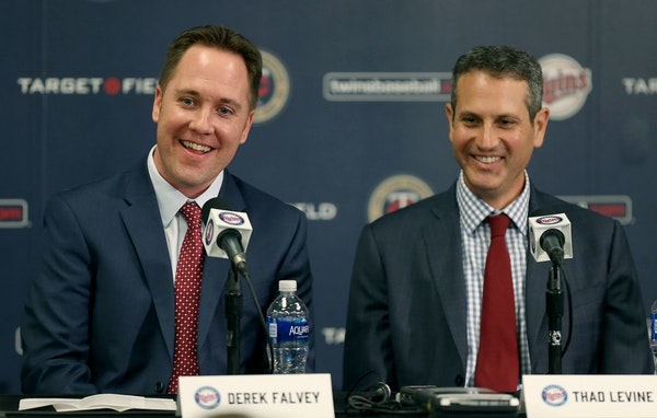 New Twins Chief Baseball Officer Derek Falvey, left, and Senior Vice President and General Manager Thad Levine were all smiles after they were introdu