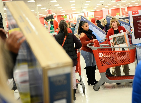 The Target in Eden Prairie was busy Thursday night as shoppers there made their way past big screen TV deals placed in the clothing section.