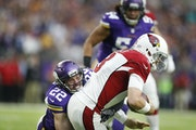 Vikings free safety Harrison Smith (22) was one of seven key players who missed Sunday's practice.