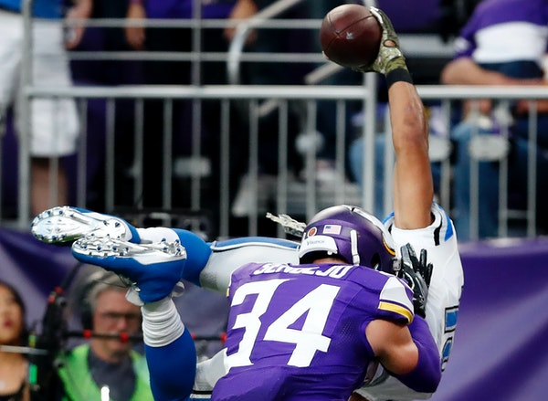 Vikings safety Andrew Sendejo (34) hit Lions receiver Golden Tate as he lunged into the end zone to score the winning touchdown in overtime Nov. 6. De