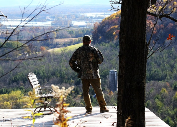 A Buffalo County deer hunter who asked for anonymity looked out over his hunting and forest land from a deck high above the Upper Mississippi River Va