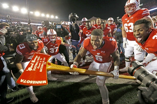 Wisconsin running back Corey Clement took the Paul Bunyan's Axe to the goalpost after the Badgers defeated Minnesota 31-17 at Camp Randall Stadium on