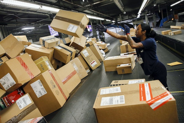 An employee sorted packages inside the FedEx Corp. distribution hub at Los Angeles International Airport in December 2014.