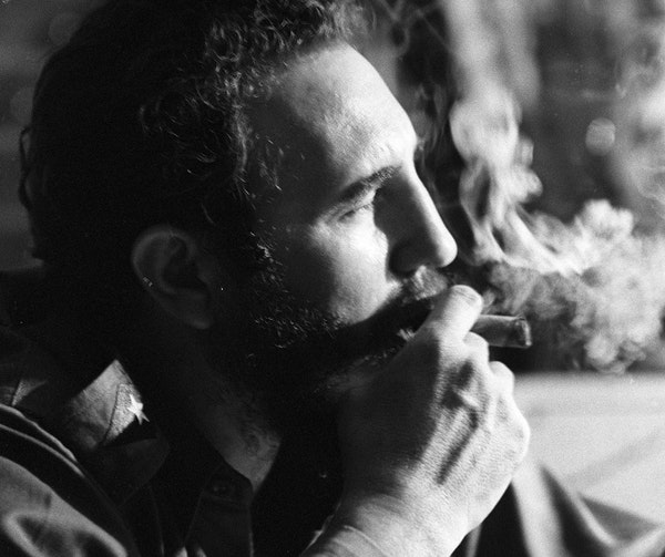 Fidel Castro in 1964 with his trademark cigar during an interview in one of his Havana apartments. Castro, who ruled Cuba for nearly half a century, d