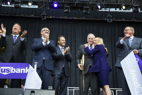 Vikings and Minnesota-Sports Facilities Authority officials, along with Gov. Mark Dayton, at the ceremonial ribbon cutting for U.S. Bank Stadium when