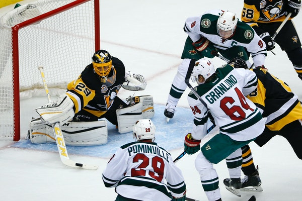 Pittsburgh Penguins goalie Marc-Andre Fleury (29) makes a stick-save during the first period of an NHL hockey game against the Minnesota Wild in Pitts