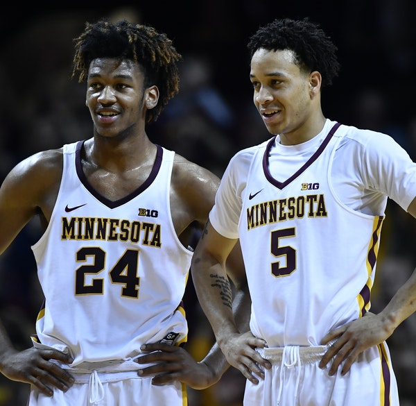 Two Gophers freshman, Eric Curry (24) and Amir Coffey, are part of an influx of new talent that has transformed the team.