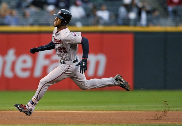 Minnesota Twins' Byron Buxton rounds the bases while hitting an inside-the-park solo home run during the first inning of a baseball game against the C