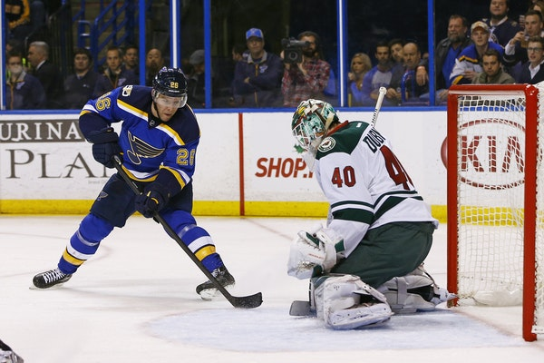 St. Louis' Paul Stastny had his shot blocked Saturday night by Devan Dubnyk, who played back-to-back days in the Wild net.