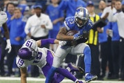 Detroit Lions cornerback Darius Slay (23) intercepts a pass intended for Minnesota Vikings wide receiver Adam Thielen (19) in the fourth quarter of an