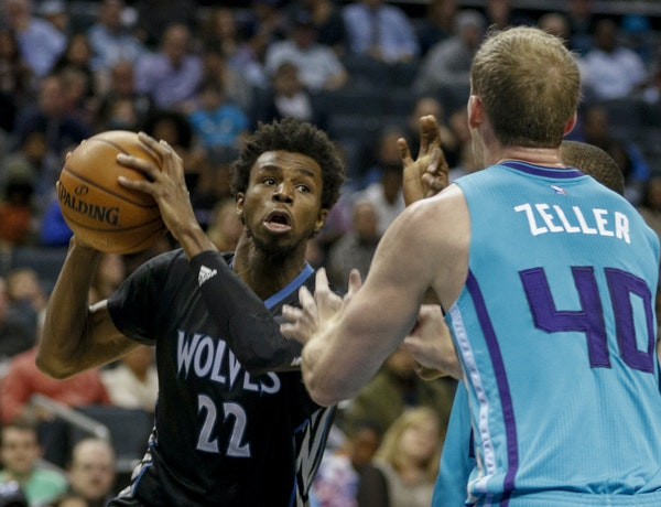 NELL REDMOND • Associated Press The Wolves' Andrew Wiggins, left, looked for an opportunity beyond Charlotte center Cody Zeller. Wiggins scored 29