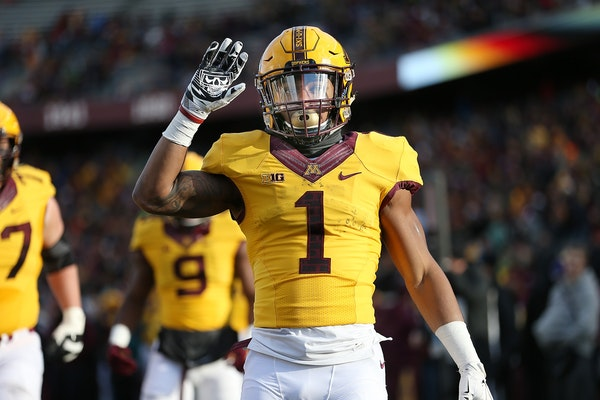 Minnesota's running back Rodney Smith celebrated his touchdown in the first quarter as Minnesota took on Northwestern at TCF Bank Stadium, Saturday, N