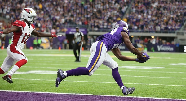 Vikings cornerback Xavier Rhodes intercepted a pass intended for Cardinals wide receiver John Brown and returned it 100 yards for a touchdown at U.S.