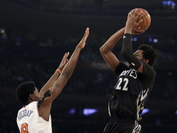 Timberwolves forward Andrew Wiggins put up a jump shot over Knicks guard Justin Holiday in the first half Friday night in New York.