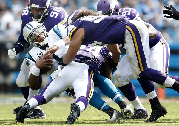 Panthers quarterback Cam Newton was surrounded by Vikings defenders Linval Joseph (98), Shamar Stephen (93), Eric Kendricks (54) and Captain Munnerlyn