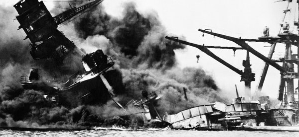The USS Arizona toppled during the attack on Pearl Harbor in Hawaii on Dec. 7, 1941.