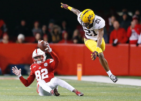 Nebraska's wide receiver Alonzo Moore made a grab despite Gophers defensive back Ray Buford's efforts during the fourth quarter on Nov. 12.