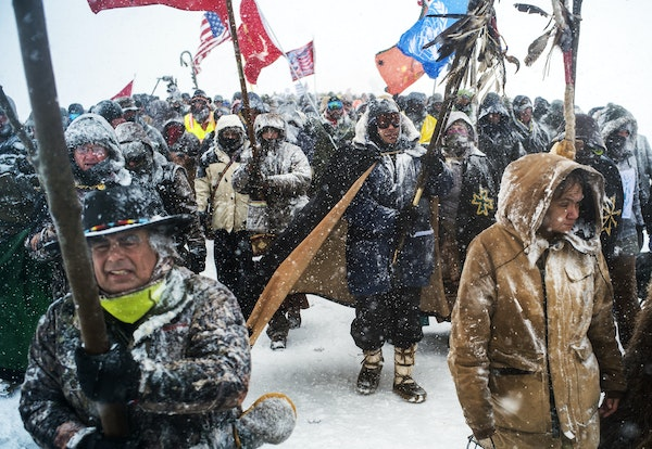 Veterans marched to a blockaded bridge leading to the pipeline site.