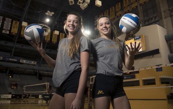Sisters Hannah Tapp, left, and, Paige Tapp both worked harder than they ever thought they could as members of the Gophers volleyball team. Success fol