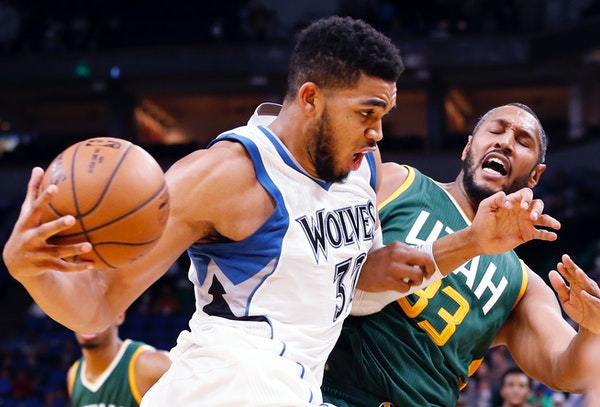 Minnesota Timberwolves' Karl-Anthony Towns, left, drives into Utah Jazz's Boris Diaw of France in the second half of an NBA basketball game Monday, No