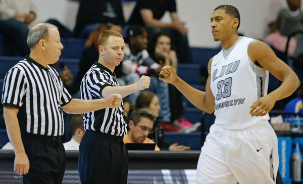 LIU Brooklyn forward Jerome Frink (33) greeted referees before his team's Nov. 19 game against Maine. Frink and LIU Brooklyn played the Gophers on Wed